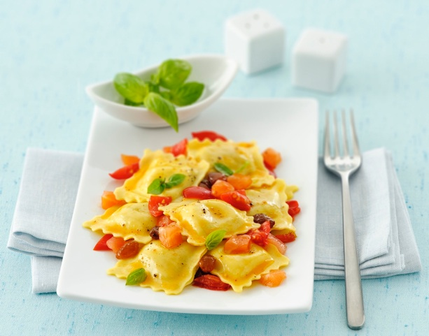 Tortellini-peas-filled-with-salmon-and-tomato-sauce-and-basil-leaves-on-modern-light-blue-tableset by aw 6.4.1.