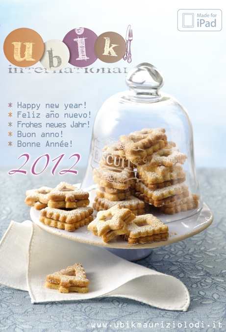 christmas-cookies-in-and-out-a-cakestand-on-blue-table-cloth-ubik-magazine-app-greetings by Macintosh.