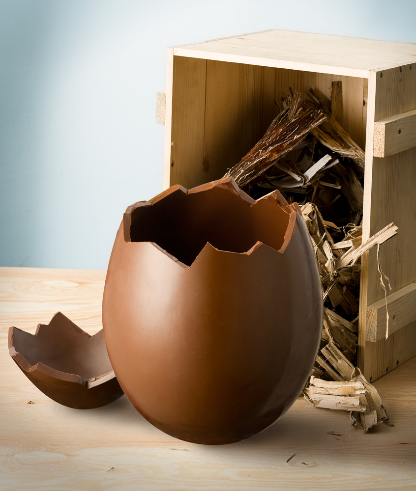 easter dark chocolate egg beside a wooden box