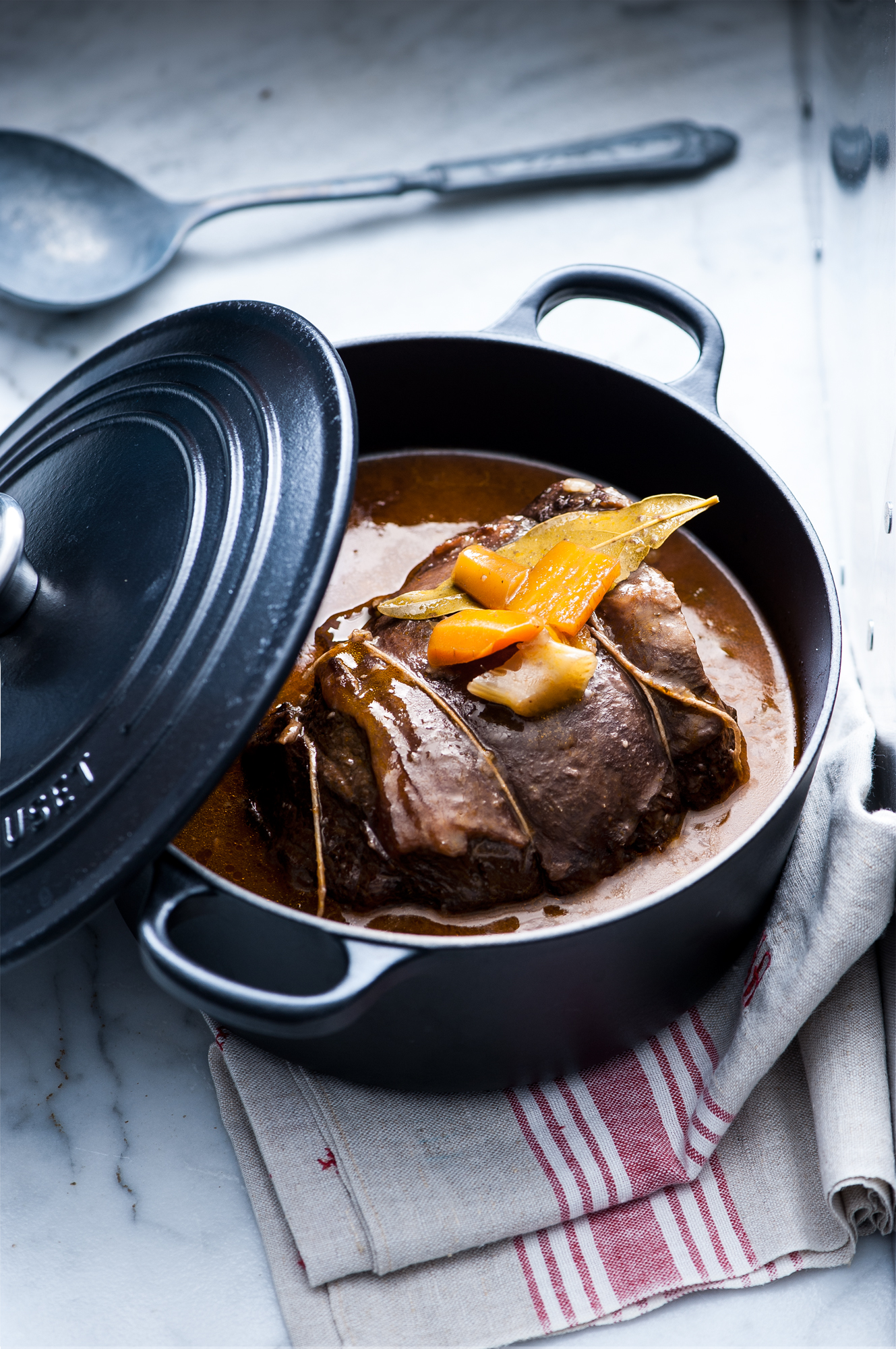stewed meat in a black cast iron pot